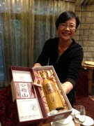 Madame Xu and a bottle of very good rice wine